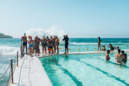 Group of People Standing by the Pool