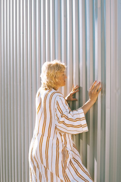 Woman Touching Textured Silver Wall