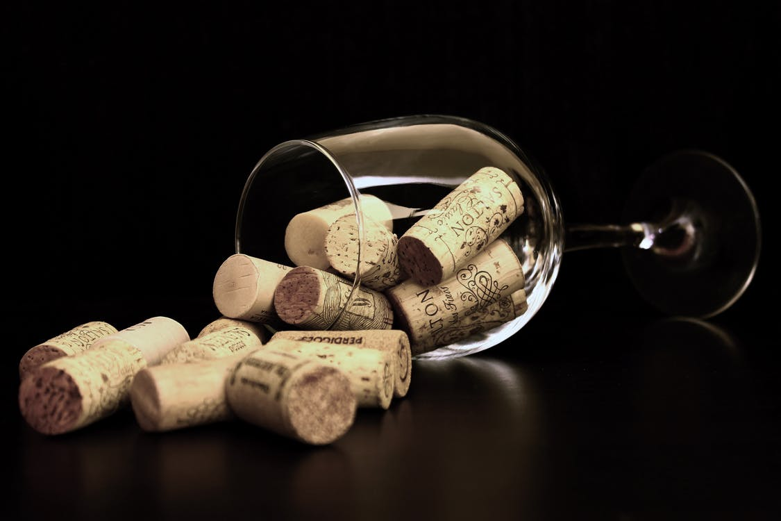 Brown Corks on Clear Wine Glass