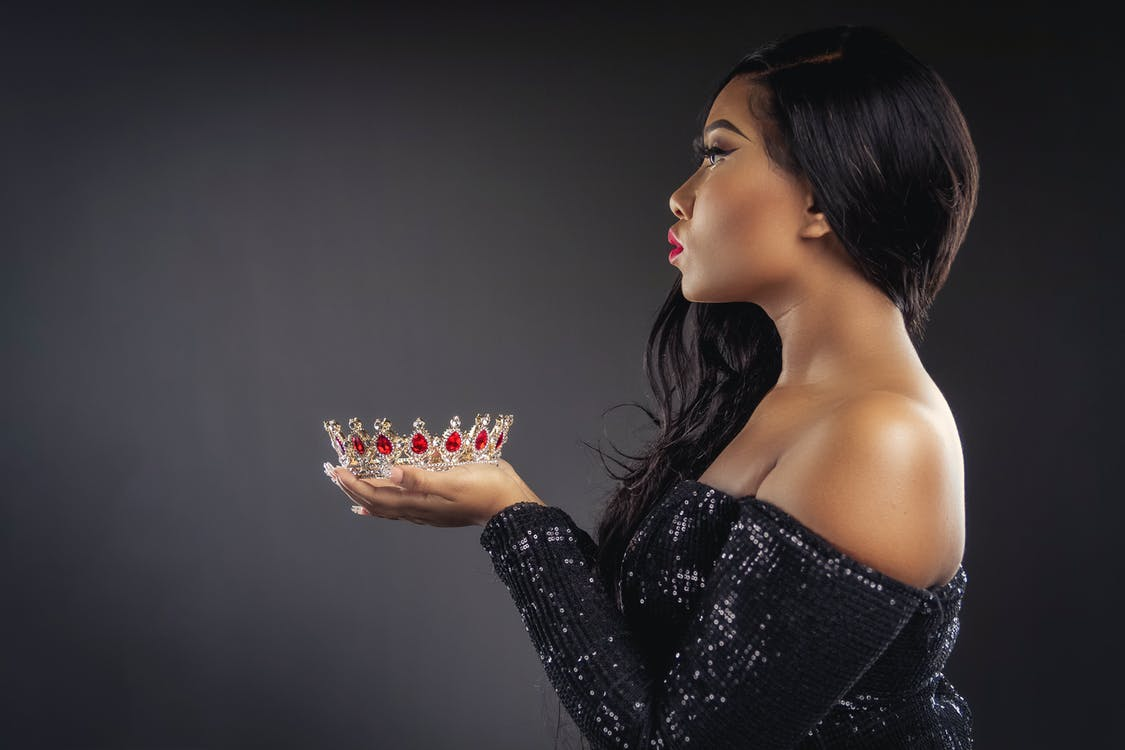 Photo Of Woman Holding Crown