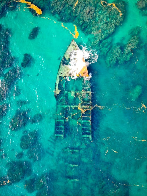 Aerial View of a Ship Wreck on Body of Water