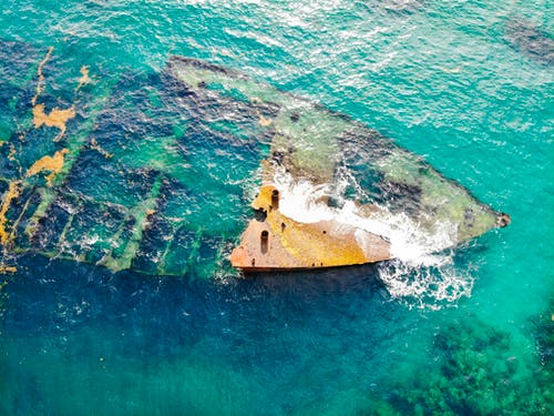Aerial View of Shipwreck in the Middle of Ocean