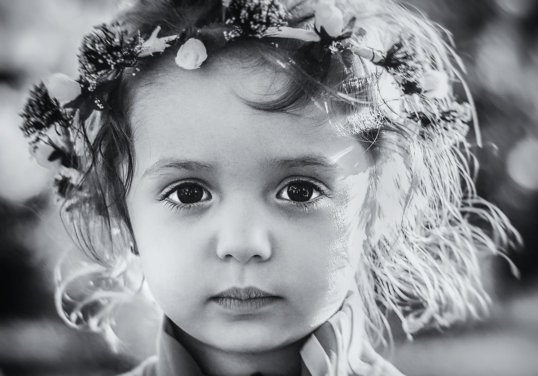 Photo Gray Scale of a Child With Floral Tiara