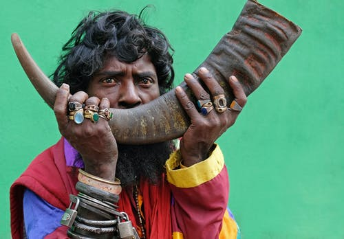 Man Holding a Animal Horn