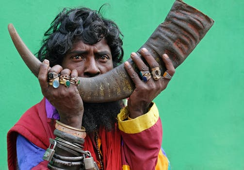 man holding a animal horn