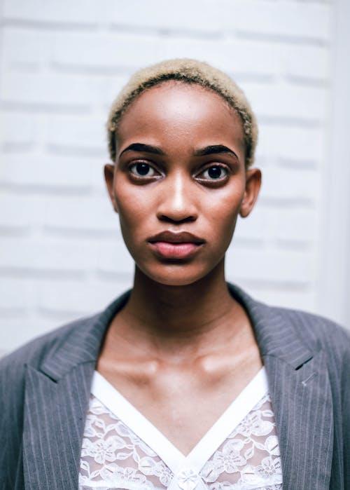 Portrait Photo Of Woman Wearing Grey Blazer