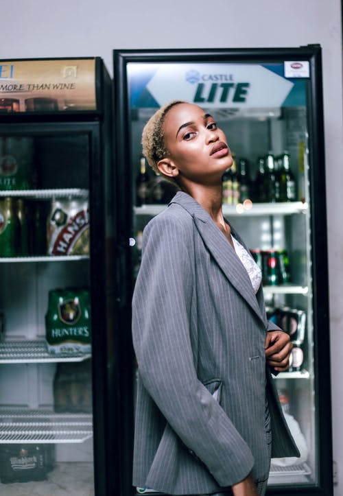 Photo Of Woman Standing Near Refrigerator