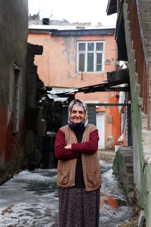 Adult Woman Wearing Headscarf Standing Near Buildings