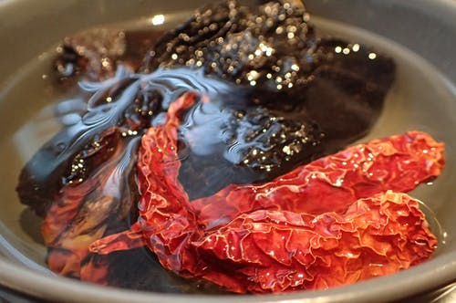 Free stock photo of Dried chili being rehydrated