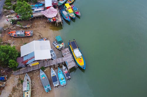 Blue and Yellow Boats on Dock