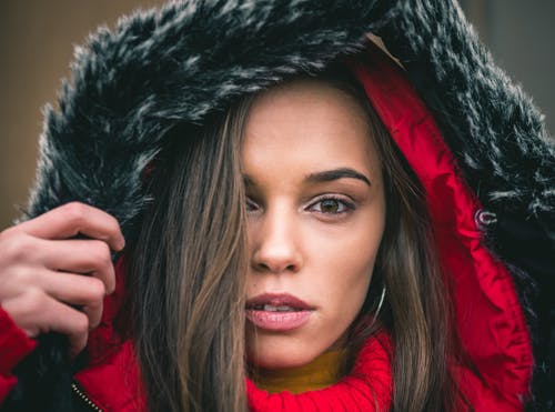 Woman in Red and Black Fur Hoodie