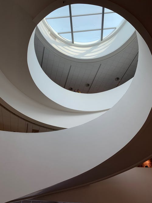 White Concrete Spiral Staircase With Glass Windows