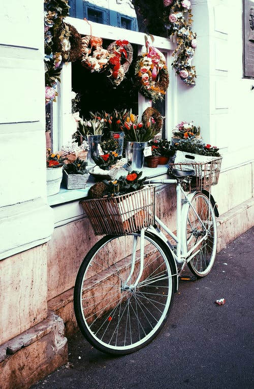 White Bicycle With Flowers on Basket