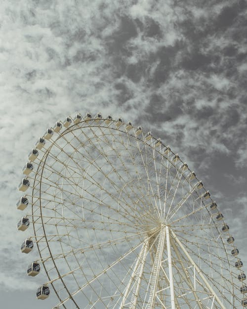 White Ferris Wheel Under Cloudy Sky