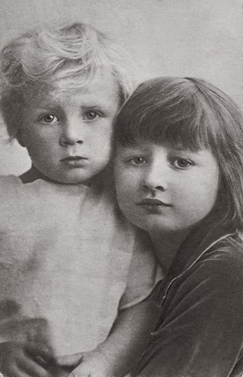 Grayscale Photo of Two Children
