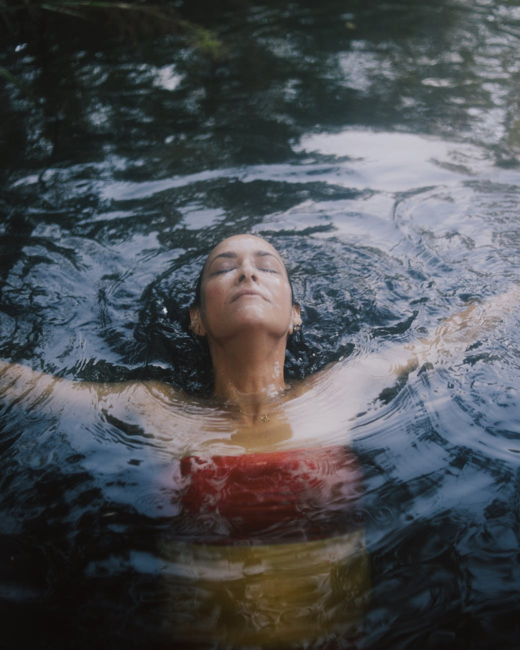 Woman in Red Tube Top in Swimming in water