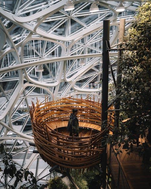 Man in Black Hoodie Jacket on Woven Basket