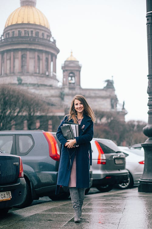 Street Photography of Woman Wearing Blue Coat