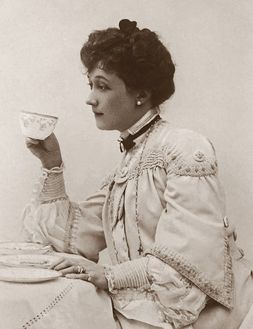 Classic Photo of a Woman Holding a Tea Cup