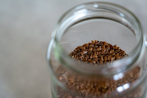 Close-up Shot On Seeds Inside Glass Container
