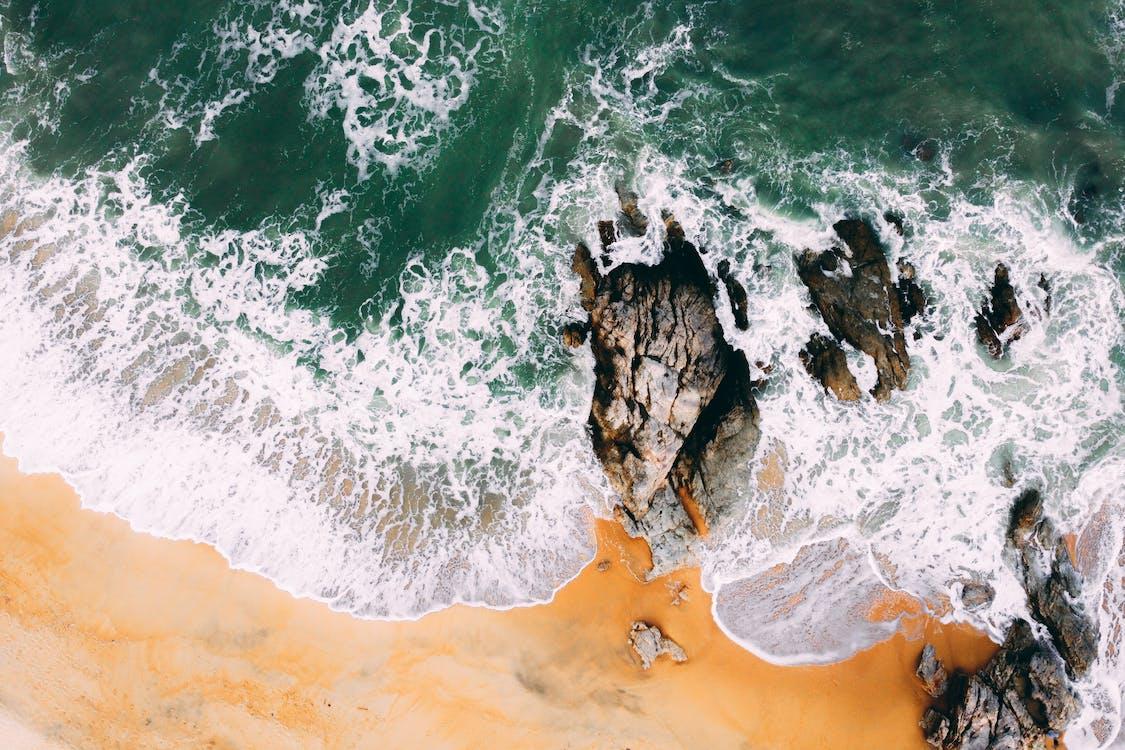 Seashore Wave Crashing on Rock Formation