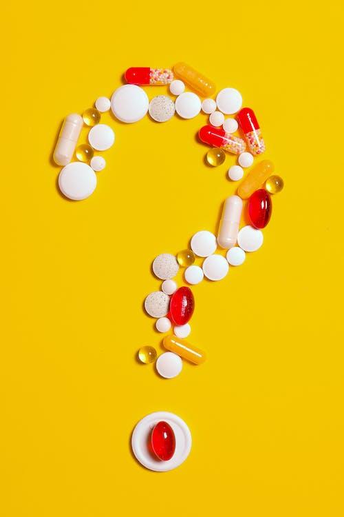 Medication Pills on Yellow background