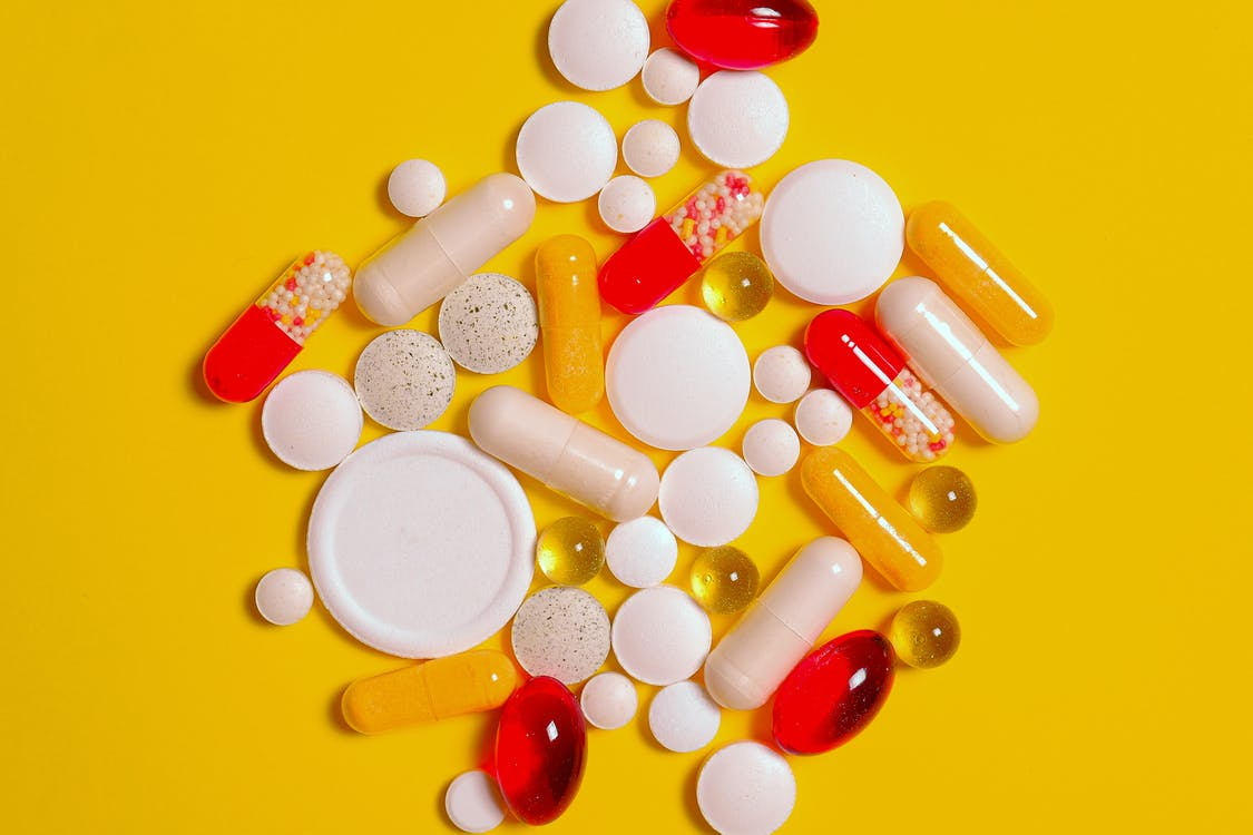 Bunch of White Round Medication Tablets