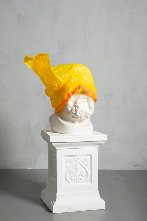 Sculpture Covered Yellow Plastic on White Background
