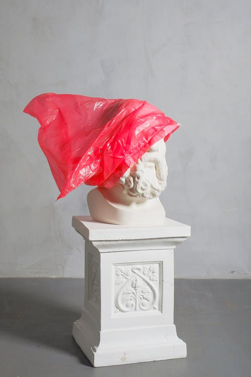 A Photo Of Art Sculpture Covered with Red Plastic
