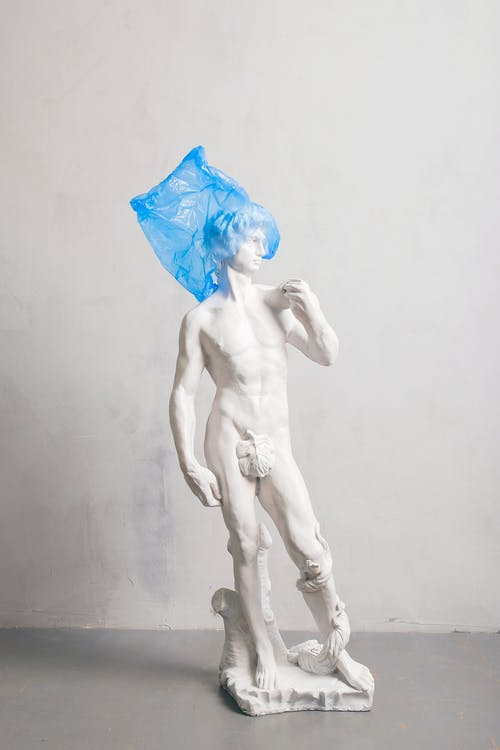White Nude Sculpture Covered Blue Plastic on Head