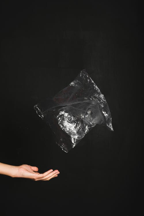 A Person Throwing a Plastic Bag