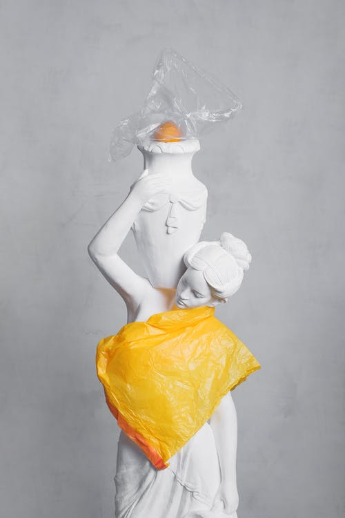 Woman White Sculpture and Orange Plastic
