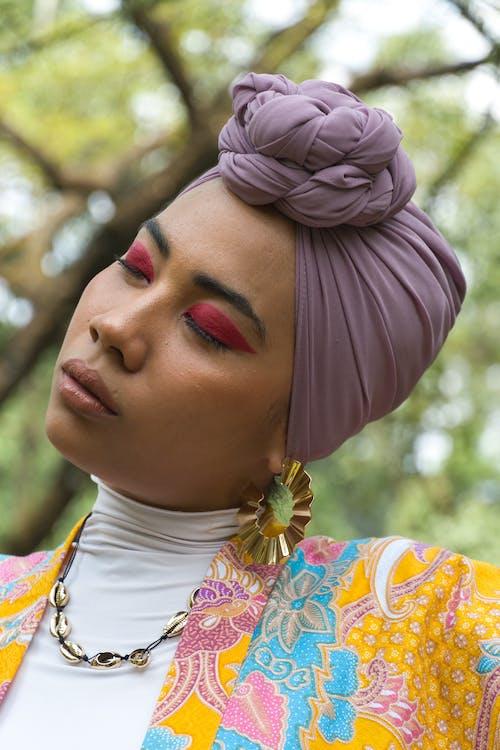 Woman With Purple Hijab Wearing Gold Earings