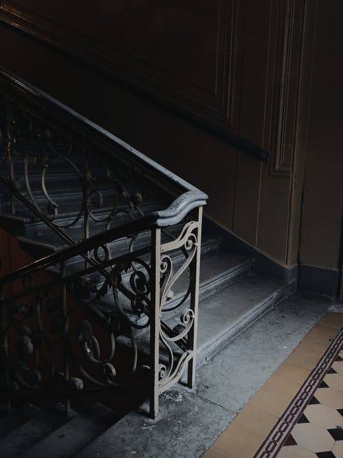 Staircase With Black Metal handrail