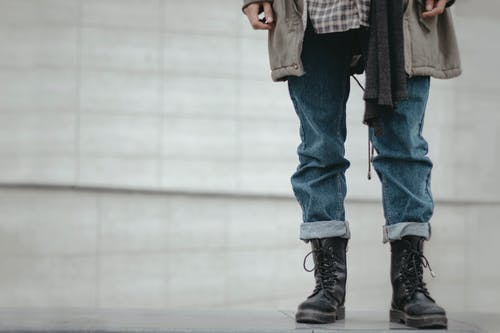 Photo Of Person Wearing Denim Pants