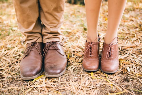 A Photo Of A Couple Wearing A Classic Brown Leather Shoes