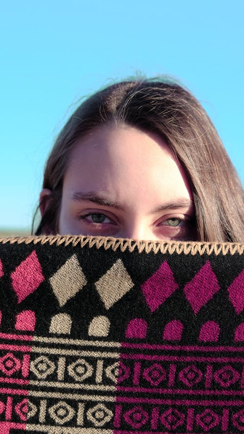 Woman Cover Half Face with Black Purple Scarf