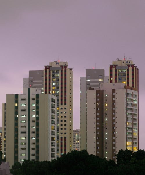 Photo Of Buildings During Dawn