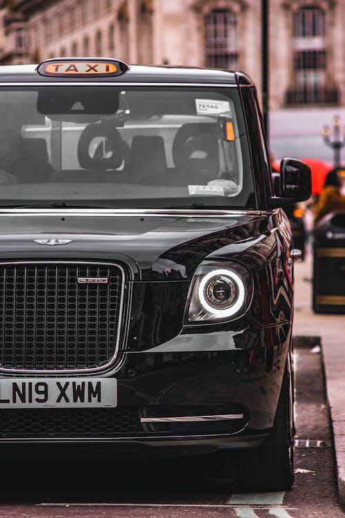 Black Taxi on Street