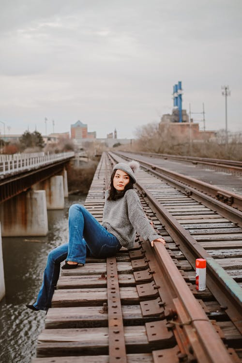 Photo Of Woman Sitting On Trail Road
