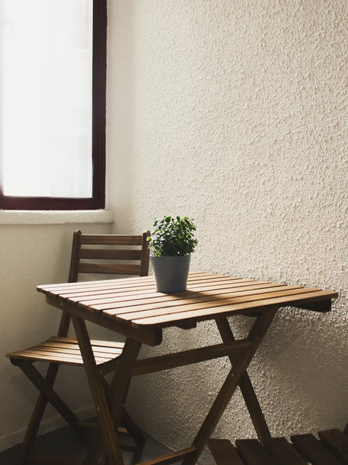 Brown Wooden Table and Chair