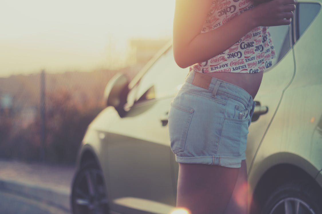 Woman Standing Beside Parked Car