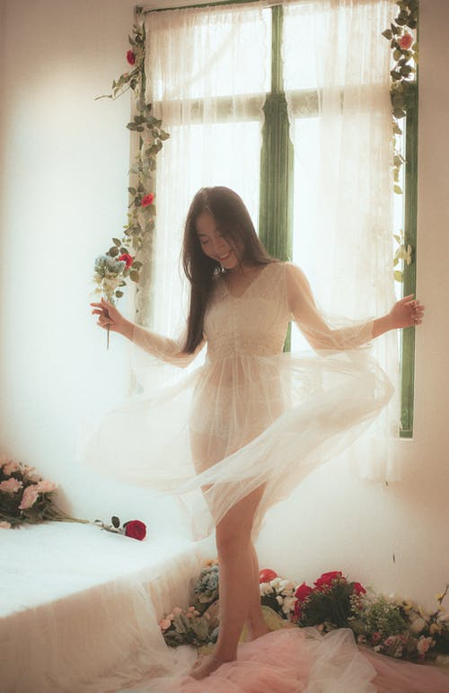 Photo Of Woman Wearing White See Through Dress