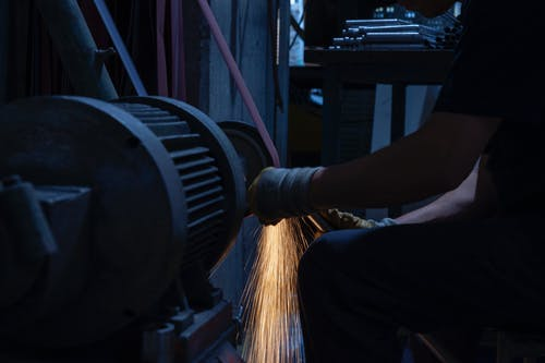 Man Grinding A metal