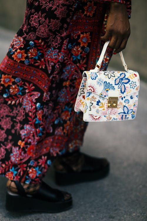 Photo Of Person Holding White Handbag