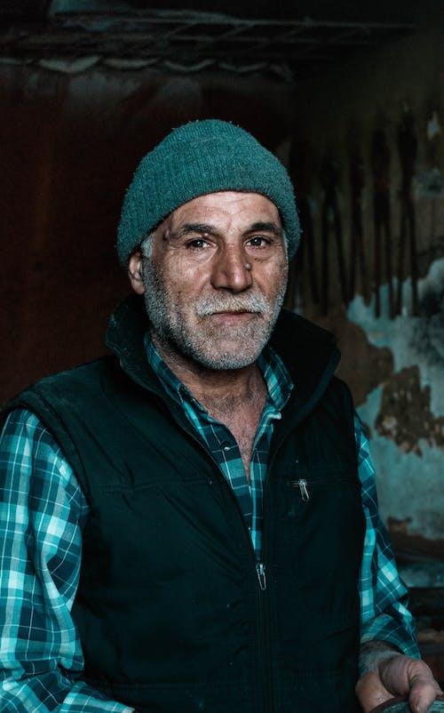 Portrait Photo of Elderly Man in Blue Jacket Wearing a Beanie hat