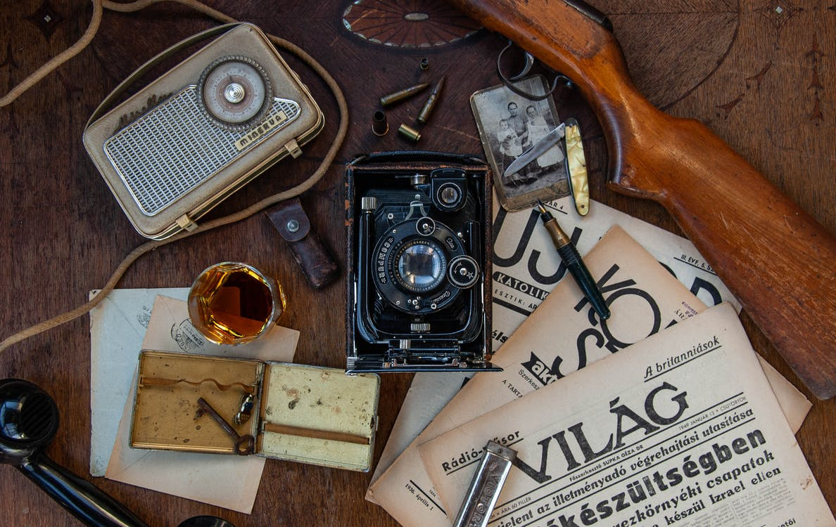 Black and Silver Antique Camera on Brown Wooden Table