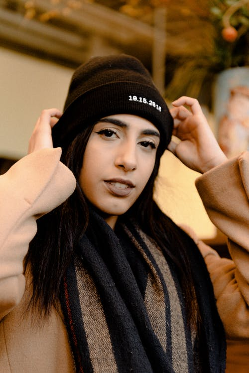 Woman Wearing Black Knit Cap and Brown Coat