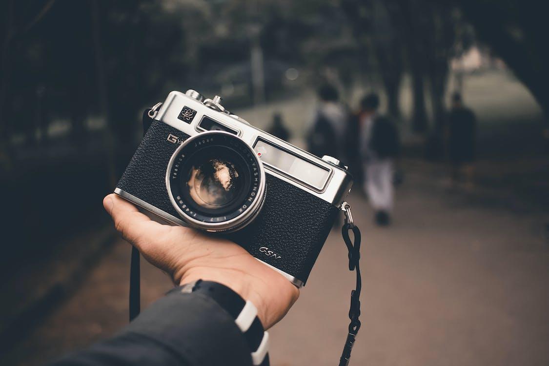 Person Holding Black Silver Camera