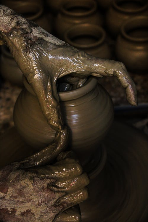 Photo Of Person Making Clay Pot